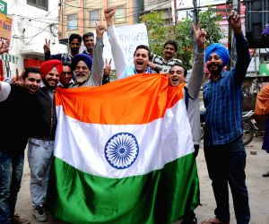 Fans celebrate as India defeats South Africa in a World Cup match