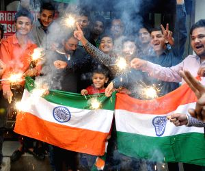 People celebrate India's win in World Cup semi-finals