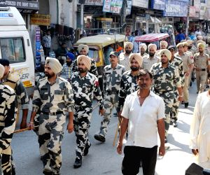 Policemen conduct a flag march on the eve of Operation Bluestar