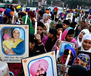 Sikh activists' participate in candlelight vigil on Human Rights Day