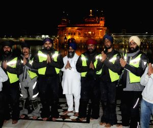 Six Sikh Malaysian bikers at Golden Temple