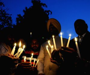 Candlelight vigil on Human Rights Day