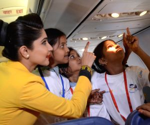 """An air hostess with the children during  """"Flight of Fantasy"""" organised for children by Jet Airways ahead of Children's Day at Chhatrapati Shivaji International Airport in Mumbai on ..."""