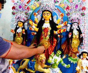 Preparations for Durga Puja celebrations on full swing at Kumartuli workshop