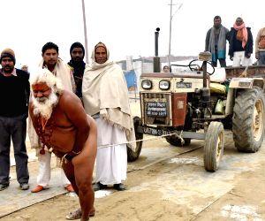 Magh Mela - ascetic pulls a tractor