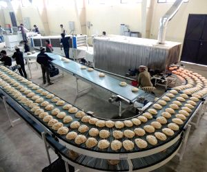 An automatic roti making plant which can make 70000 rotis weighing 70 gram each in one hour