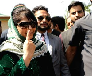 Anantnag: Peoples Democratic Party (PDP) President and the party's Lok Sabha candidate from Anantnag, Mehbooba Mufti shows her inked finger after casting her vote for the third phase of 2019 Lok Sabha elections, in Jammu and Kashmir's Anantnag, on Ap