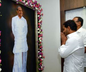 Andhra Pradesh Chief Minister Y.S. Jagan Mohan Reddy pays tributes to his father Y. S. Rajasekhara Reddy after occupying his office in the State Secretariat in Amaravati, on June 8, 2019. ...