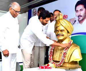 Andhra Pradesh Chief Minister YS Jagan Mohan Reddy pays tributes to his father Y. S. Rajasekhara Reddy at the YSR Congress Legislature party meeting at Tadepalli in Guntur, Andhra Pradesh on ...