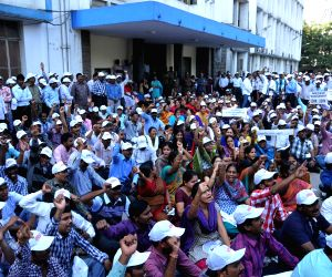 Andhra Pradesh State Electricity Board employees demonstrate to demand implementation of PRC Report