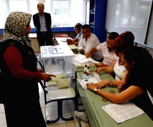 Turkey's Erdogan wins absolute majority in crucial elections