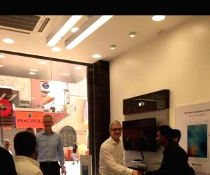 Cook begins Delhi leg, visits Apple office, iStore