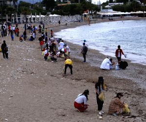 GREECE ATHENS BEACH VOLUNTEERS CLEANING UP