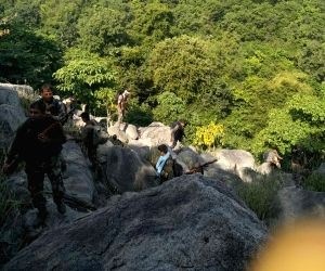Aurangabad: The members of combined team of Central Reserve Police Force's (CRPF) CoBRA battalion and Special Task Force (STF) who killed three Maoists in an encounter in Bihar's Satnadia forest area of the Aurangabad district on July 25, 2019. (Phot