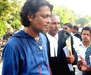 Author of book on Aarushi, Avirook Sen at Allahabad High Court premises on Oct 12, 2017. Dentist couple Rajesh and Nupur Talwar were acquitted in the double murder of their daughter ...