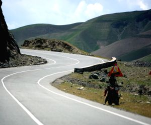 A vehicle travels on a high way in Badkhshan province in northern Afghanistan