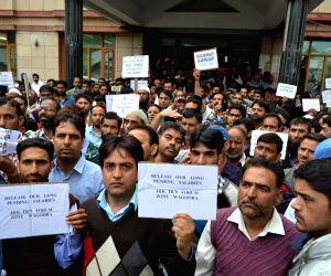 Teachers demonstrate to demand  pending salaries