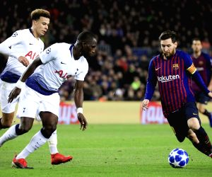 BARCELONA, Dec. 12, 2018 - FC Barcelona's Lionel Messi (R) competes during an UEFA Champions League Group B match between FC Barcelona and Tottenham Hotspur in Barcelona, Spain on Dec. 11, 2018. The ...