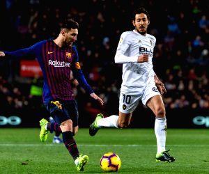 BARCELONA, Feb. 3, 2019 - FC Barcelona's Lionel Messi (L) competes during a Spanish La Liga match between FC Barcelona and Valencia in Barcelona, Spain, on Feb. 2, 2019.