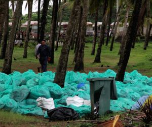 Waves deposit debris on Goa beaches