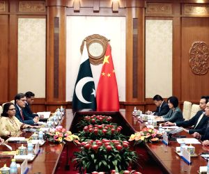 BEIJING, Aug. 9, 2019 - Chinese State Councilor and Foreign Minister Wang Yi holds talks with Pakistani Foreign Minister Shah Mahmood Qureshi in Beijing, capital of China, Aug. 9, 2019. Qureshi is in ...