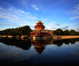 Photo taken in the early morning on July 12, 2014 shows a watchtower of the Palace Museum, also known as the Forbidden City
