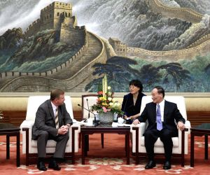 Wang Qishan meets with Andrei Kobyakov