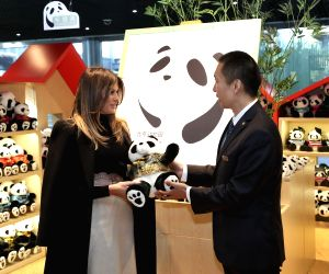 BEIJING, Nov. 10, 2017 - U.S. First Lady Melania Trump (L) receives a giant panda doll during her visit to the giant panda enclosure at the Beijing Zoo in Beijing, capital of China, Nov. 10, 2017.