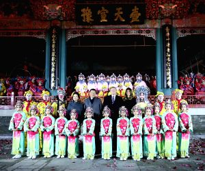 BEIJING, Nov. 8, 2017 - Chinese President Xi Jinping and his wife Peng Liyuan, and U.S. President Donald Trump and his wife Melania Trump pose for a photo with performers after watching a Peking ...