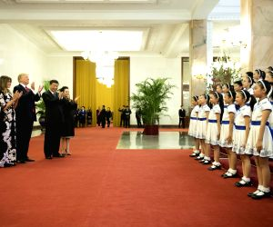 BEIJING, Nov. 9, 2017 - Chinese President Xi Jinping (3rd L) and his wife Peng Liyuan (4th L), and U.S. President Donald Trump (2nd L) and his wife Melania Trump (1st L) watch a performance at the ...