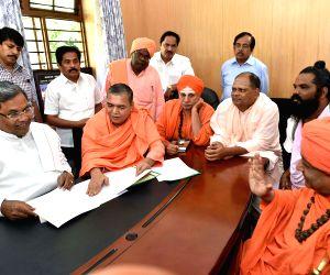 Ascetics meet Karnataka CM