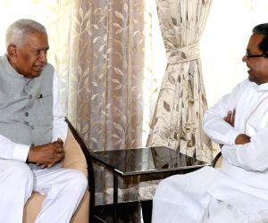 Karnataka CM calls on governor on new year