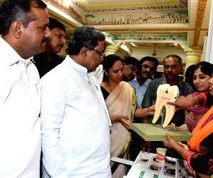 Karnataka CM at the inauguration of the Dantha Bhagya Scheme