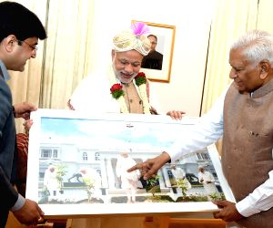PM Modi felicitated by Karnataka Governor