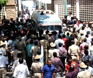 Karnataka IAS officer's body being taken away after postmortem