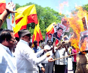 Protest against O Panneerselvam and J Jayalalithaa