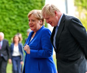 BERLIN, Aug. 21, 2019 (Xinhua) -- German Chancellor Angela Merkel (L) talks with visiting British Prime Minister Boris Johnson in Berlin, Germany, on Aug. 21, 2019. Angela Merkel and Boris Johnson on Wednesday reiterated the Brexit with a deal, but w