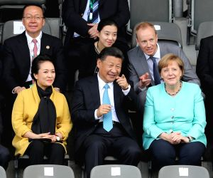 GERMANY-CHINA-XI JINPING-MERKEL-YOUTH FOOTBALL MATCH