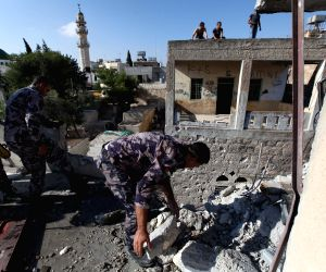 Gaza Strip: Damaged building hit by a rocket