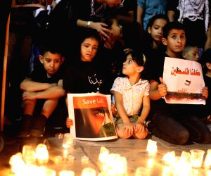 Palestinians light candles