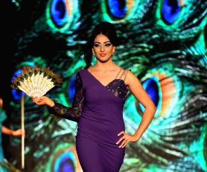 A Palestinian model displays a dress during a fashion show