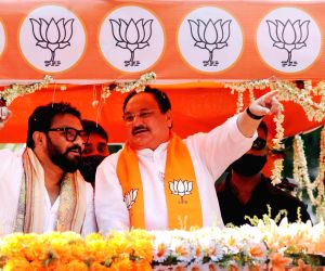 Kolkata : Bharatiya Janata Party (BJP) National President, JP Nadda along with BJP candidate for Tollygunge constituency, Union Minister of State for Environment, Forest and Climate Change, Babul Supriyo at a road show ahead of the 3rd phase of State Assembly election in Kolkata on April 5, 2021.