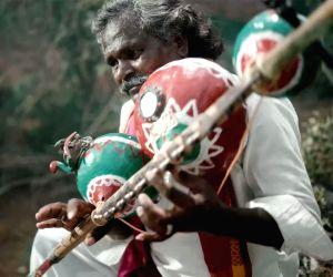 'Bheemla Nayak' composer Thaman felicitates folk singer Mogulaiah
