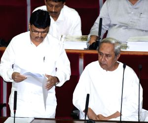 Bhubaneswar: Odisha's Finance Minister Niranjan Pujari presents the state's annual budget for 2019-20, at the state Assembly in Bhubaneswar on June 28, 2019. Also seen Odisha Chief Minister Naveen Patnaik. (Photo: IANS)