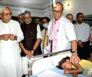 Bihar Chief Minister Nitish Kumar accompanied by Deputy Chief Minister Sushil Kumar Modi visits children with encephalitis symptoms at a hospital in Muzaffarpur, Bihar, on June 18, 2019.