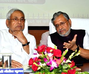 Bihar Chief Minister Nitish Kumar in a conversation with Deputy Chief Minister Sushil Kumar Modi during a programme, in Patna on Aug 14, 2018.