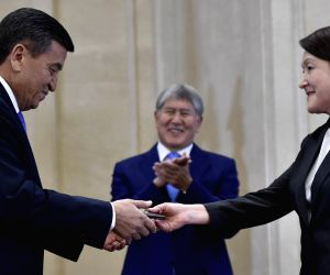 BISHKEK, Nov. 24, 2017 - The chairwoman of the Central Election Commission Nurzhan Shaildabekova (R) hands over the presidential credential to Sooronbai Jeenbekov during his inauguration ceremony in ...