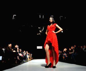 Models display creations during a Fashion Week held in Bishkek