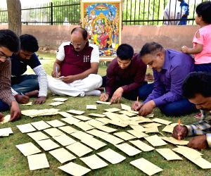 """BJP activists write """"Jai Sri Ram"""" on postcards that will be sent to West Bengal Chief Minister Mamata Banerjee, in Bikaner on June 3, 2019. Banerjee on Thursday lost her cool for ..."""