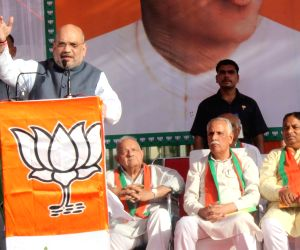 Rahul should apologize for Azad, Soz's statements, demands Amit Shah